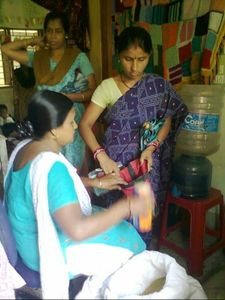 PUJA ROUTH'S MOTHER RECEIVING RATION