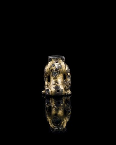 A gilt bronze support fitting, Han dynasty