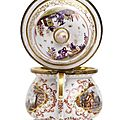 A fine Meissen porcelain creampot and cover with gold luster cartouches and landscape decoration, c. 1730