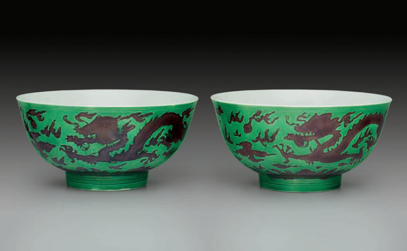 A pair of aubergine and green-glazed 'Dragon' bowls, Kangxi six-character mark in underglaze blue within a double circle and of the period (1662-1722)
