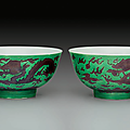 A pair of aubergine and green-glazed 'dragon' bowls, kangxi marks and period (1662-1722)