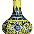 A rare yellow and green-enameled blue and white 'lotus' vase, qianlong seal mark and period (1736-1795)