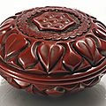 A carved circular cinnabar lacquer 'lotus' box and cover, ming dynasty, late 14th-15th century