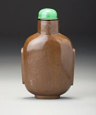 An_inscribed_and_carved_olive_green_lacquer__horse__snuff_bottle_