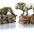 Paire de sculptures. lion et lionne en argent reposant sur une base rocheuse en améthyste. italie, vers 1930