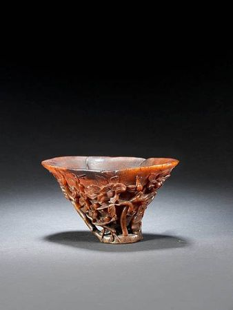 A_superb_carved_rhinoceros_horn__floral__libation_cup
