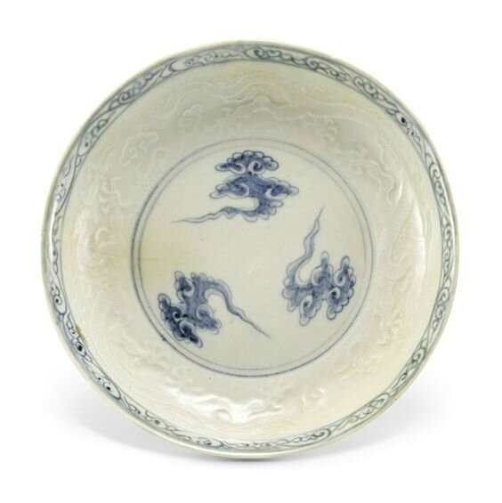 A rare blue and white anhua-decorated dish, Yuan dynasty (1279-1366)
