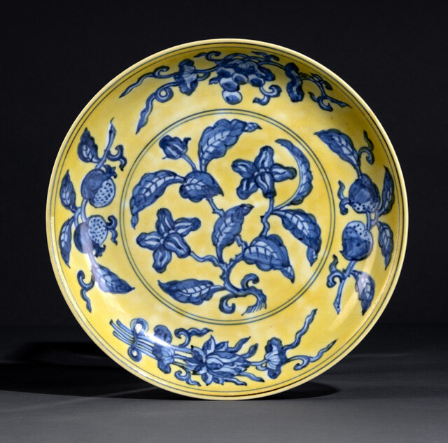 A very rare and large imperial underglaze blue yellow-ground 'Gardenia' saucer dish, Zhengde six-character mark and of the period (1506-1521)