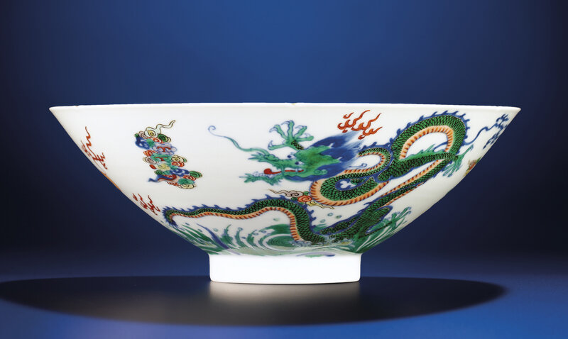 A fine doucai conical 'dragon' bowl, Yongzheng six-character mark within double-circles and of the period (1723-1735)
