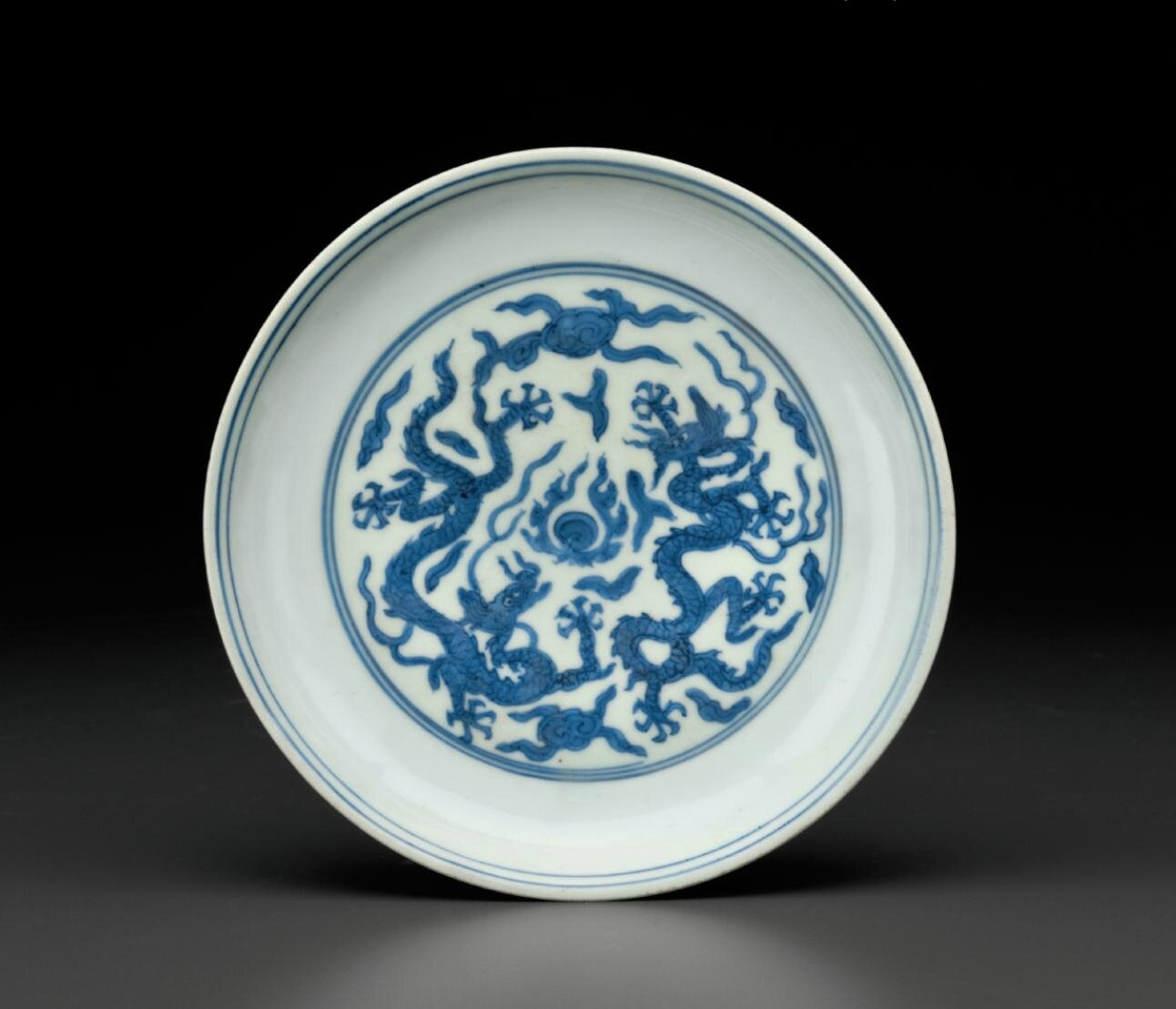 A blue and white 'Dragon' dish, Jiajing six-character mark in underglaze blue within a double circle and of the period (1522-1566)
