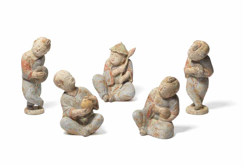 A set of five painted pottery figures of boys, Tang Dynasty (618-907)