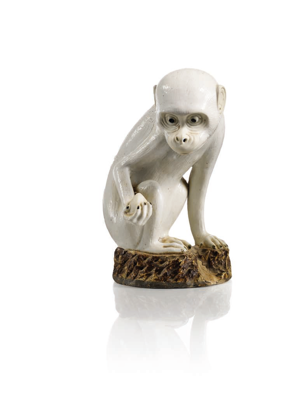 Former Collection of Miss Coco Chanel (1883-1971), A white and brown-glazed biscuit figure of a monkey, Qianlong period (1736-1795)