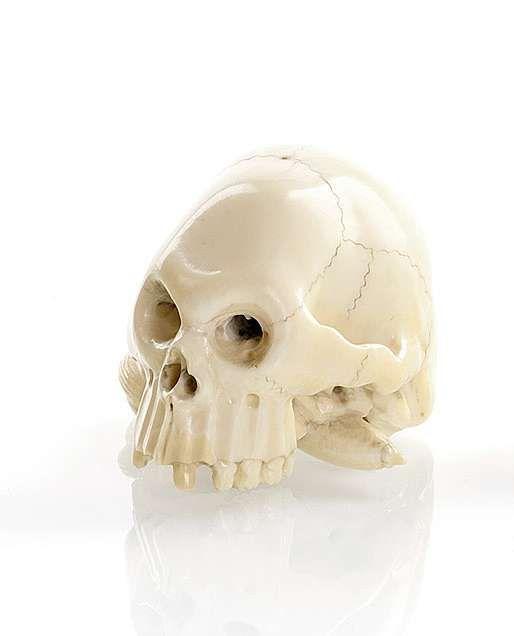 An ivory okimono of a skull, Japan, signed Tomochika, Meiji period. photo courtesy Nagel
