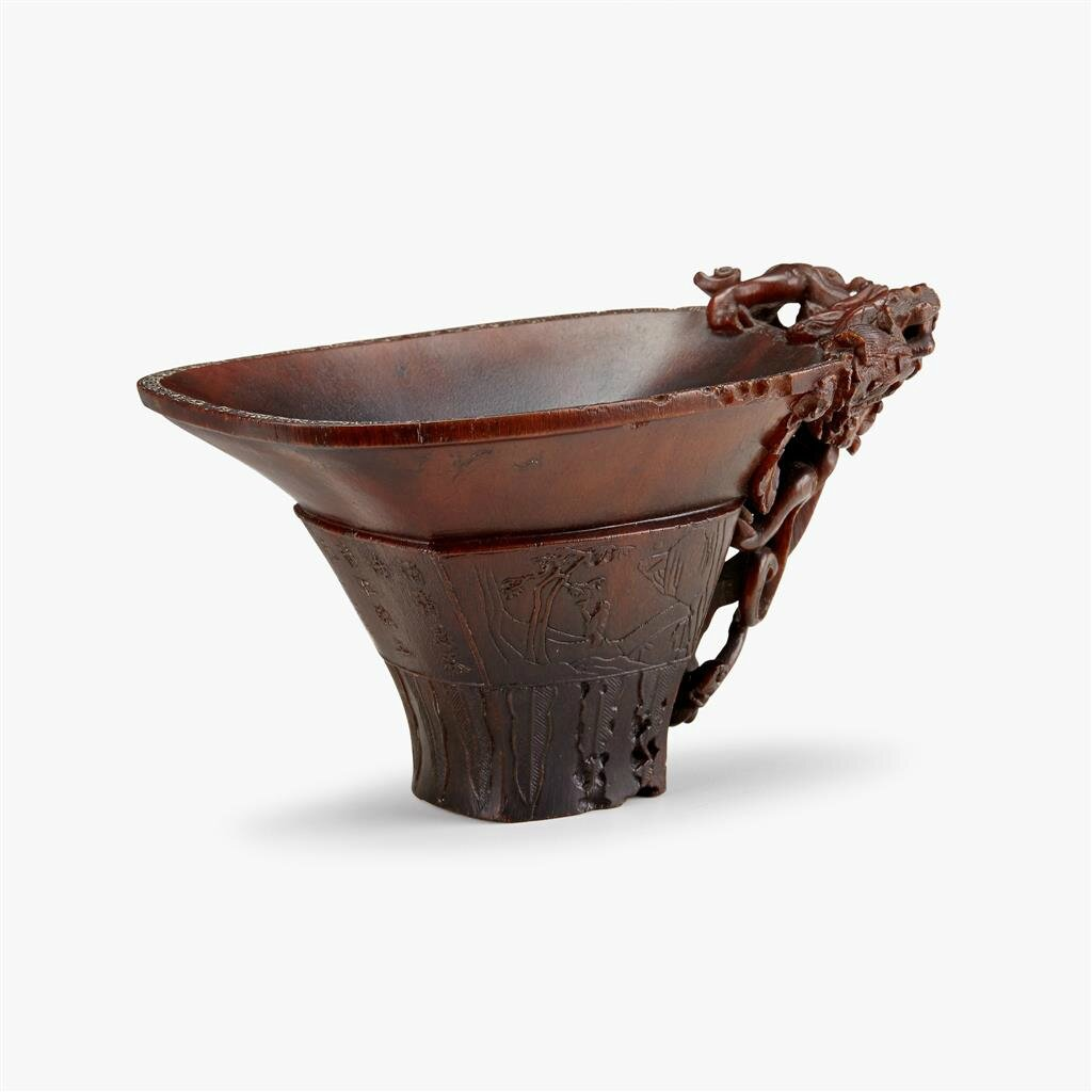 A finely carved Chinese rhinoceros horn libation cup, 18th century