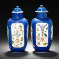 A pair of famille verte powder-blue-ground cylindrical jars and two covers. kangxi