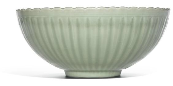 A rare large 'Longquan' celadon and biscuit 'chrysanthemum' bowl, Ming dynasty