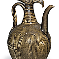 A dark olive-green-glazed phoenix-head ewer, Northern Song dynasty (AD 960-1127)