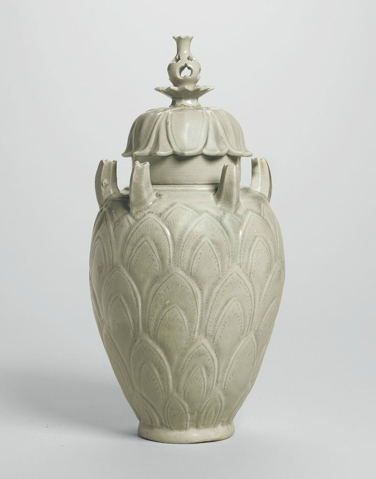 A celadon 'Grain' jar and cover, Five Dynasties - Northern Song dynasty