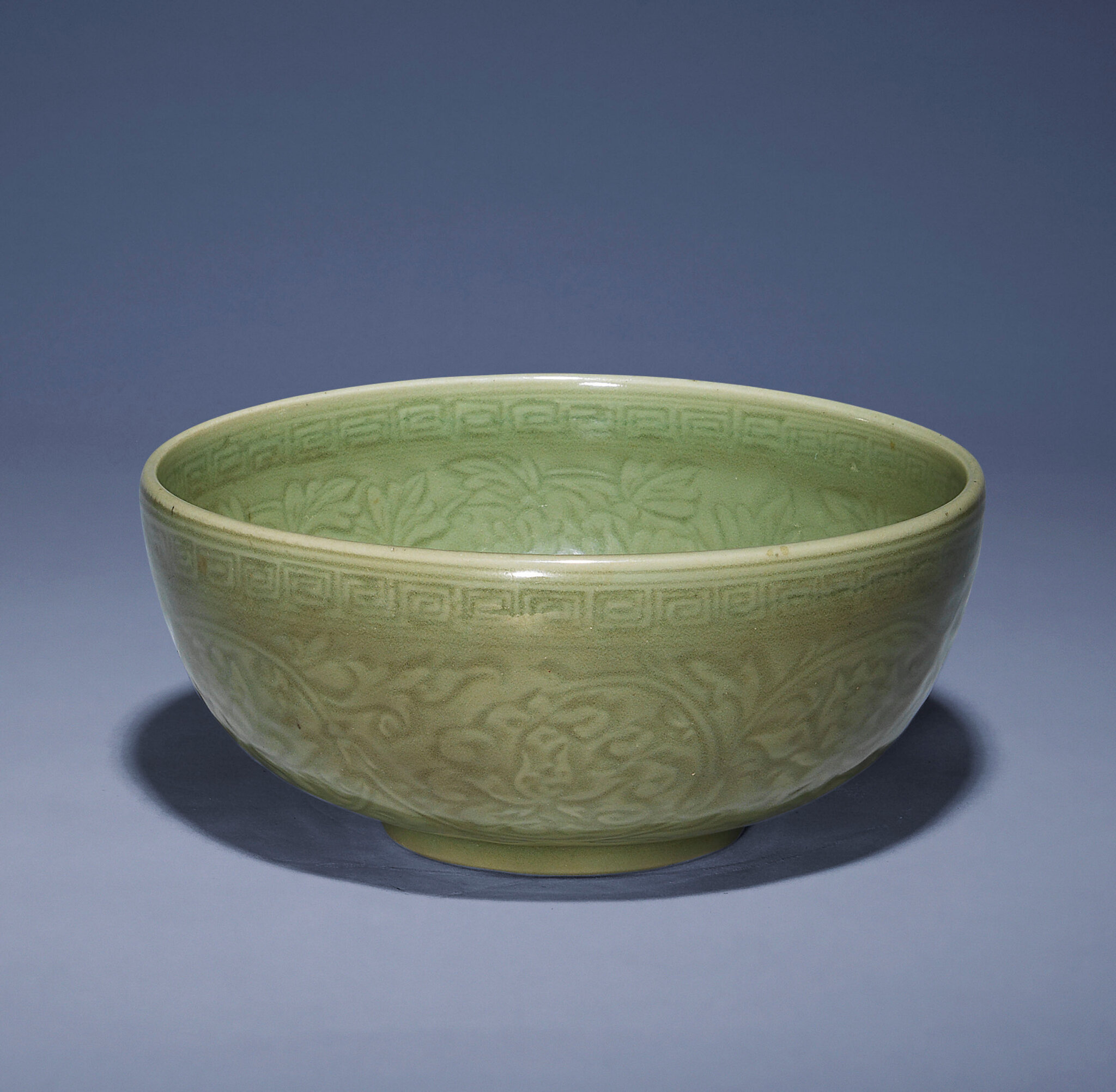 A carved Longquan celadon deep bowl, Ming dynasty, 15th century