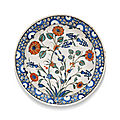 An iznik polychrome pottery dish with rosettes and hyacinths, turkey, circa 1575