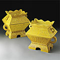 A rare pair of imperial yellow-glazed 'fu' and covers, qing dynasty, 19th century