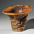 An exceptional inscribed rhinoceros horn 'drunken poet' libation cup, signed by You Kan (active 1660 - 1720), Qing dynasty, Kangxi period (1662-1722)