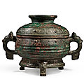 An archaic bronze ritual food vessel and cover (gui), western zhou dynasty