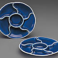A pair of blue-glazed mallow-form segmented dishes, jiaqing seal marks in underglaze blue and of the period (1796-1820)