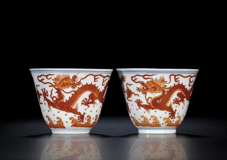 A fine pair of iron-red 'dragon' winecups, seal marks and period of Qianlong (1736-1795)