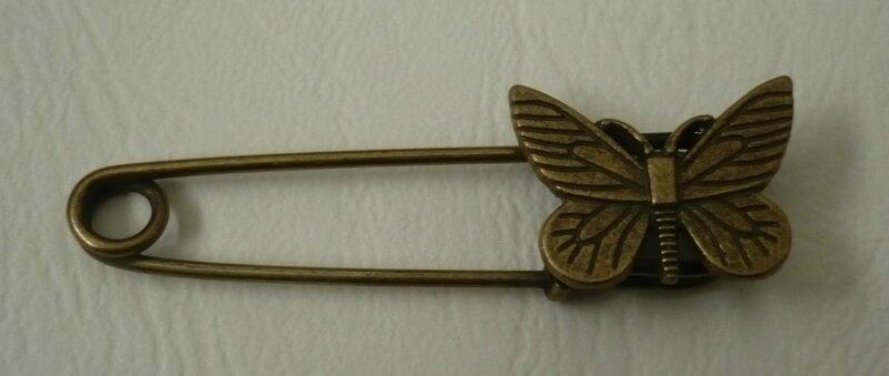 Barette papillon bronze 5,5cm 1,8€