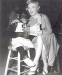 1952_MonkeyBusiness_Dressed_YellowDress_OnSet_withMonkey_030