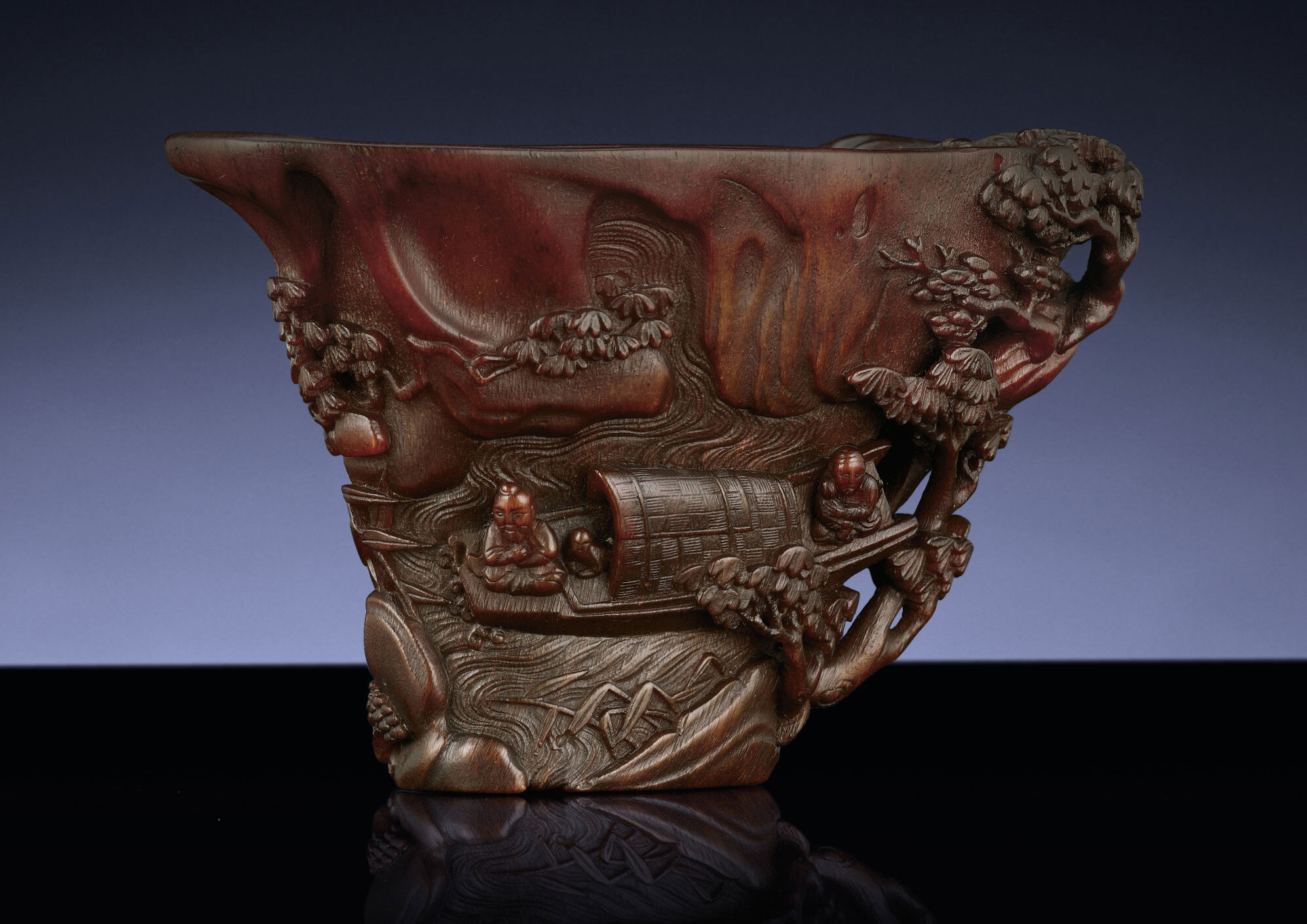 A finely carved rhinoceros horn libation cup, Qing dynasty, 17th-18th century