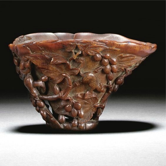 A rhinoceros horn 'Squirrel and grapevine' libation cup, Qing dynasty, Kangxi period (1662-1722