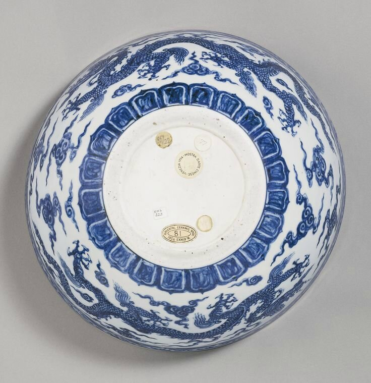 A rare and important blue and white 'Dragon' bowl (bo), Xuande mark and period 4