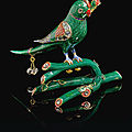 A gold and polychrome enamelled parrot perched on a branch, north india, 19th century