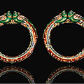 A pair of enamelled and gilded parrot head bracelets, north india, 19th century