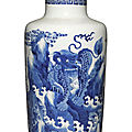 A blue and white 'mythical beast' rouleau vase, qing dynasty, kangxi period (1662-1722)
