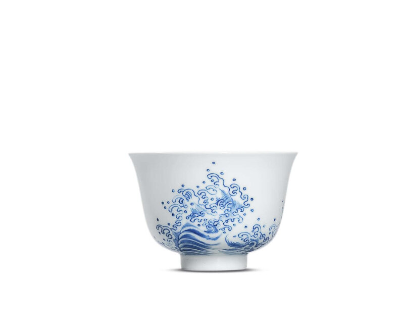 A fine and very rare blue and white 'wave' cup, Kangxi six-character mark in underglaze blue within a double circle and of the period (1662-1722)