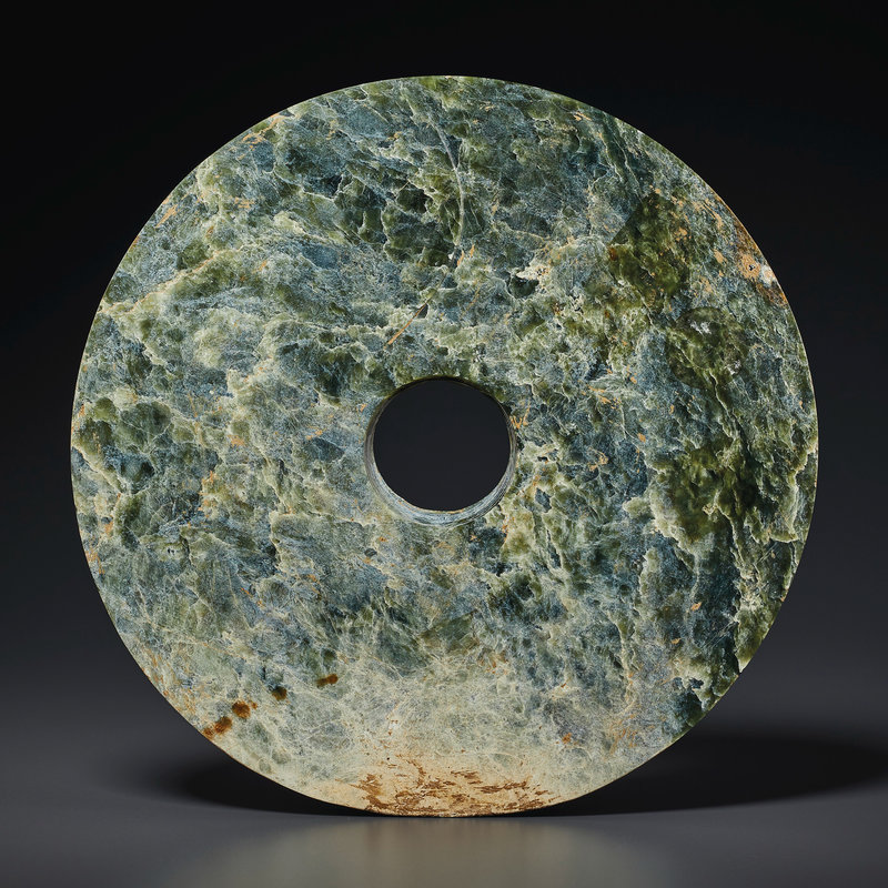 2021_NYR_19547_0702_000(a_large_mottled_green_jade_bi_disc_southeast_china_neolithic_period_3r124739)