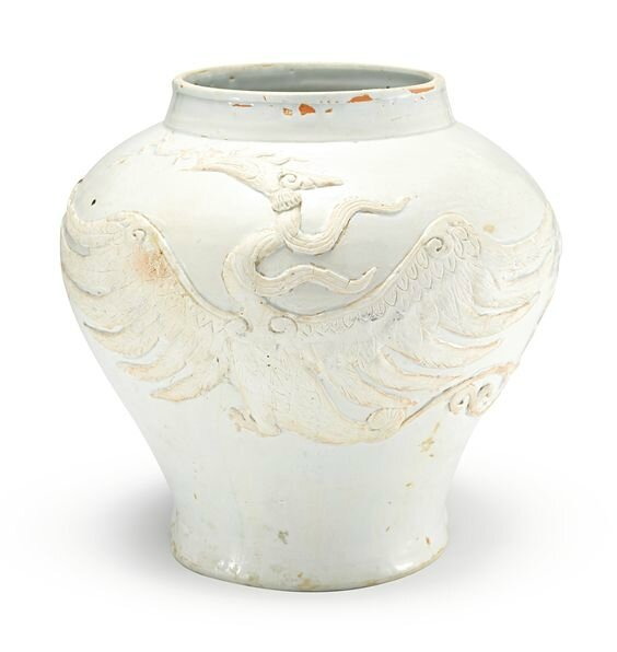 An extremely rare white-glazed 'Phoenix' jar, Yuan dynasty