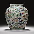 A wucai 'hundred deer' vase, wanli mark and period & a large wucai baluster vase, 17th century