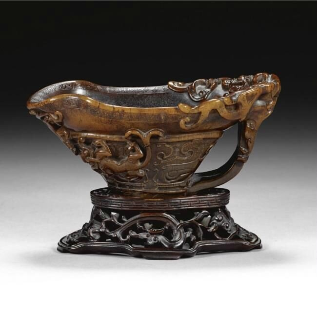 A large archaistic rhinoceros horn libation cup, 17th century