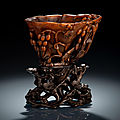 A well carved rhinoceros horn wine cup with grapewine carving, 18th century