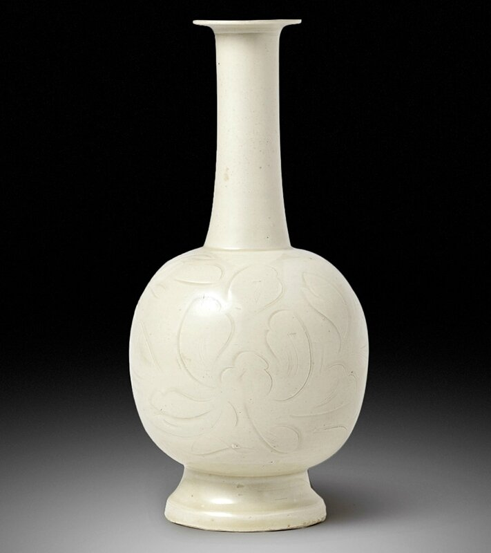 An exceptional and extremely rare Dingyao carved 'peony' bottle vase, Northern Song dynasty