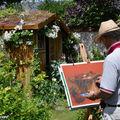 Aquarelliste s'adonnant à son art dans le jardin d'André
