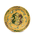 A large yellow-ground green and aubergine-enameled 'dragon' charger, qing dynasty, chuxiugong mark and guangxu period (1875-1908