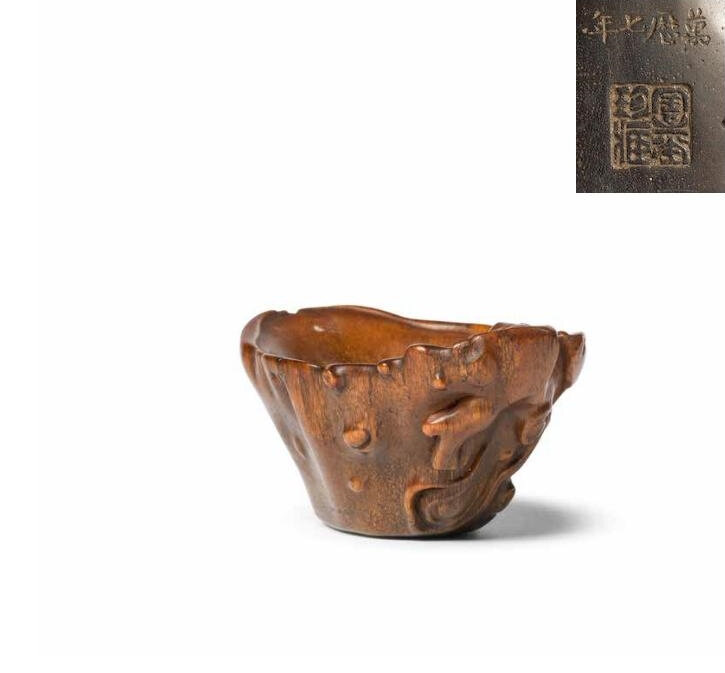 A very rare rhinoceros horn documentary libation cup, Signed Zhou Tang Zhencang, dated by inscription to the 7th year of Wanli, corresponding to 1579 and of the period