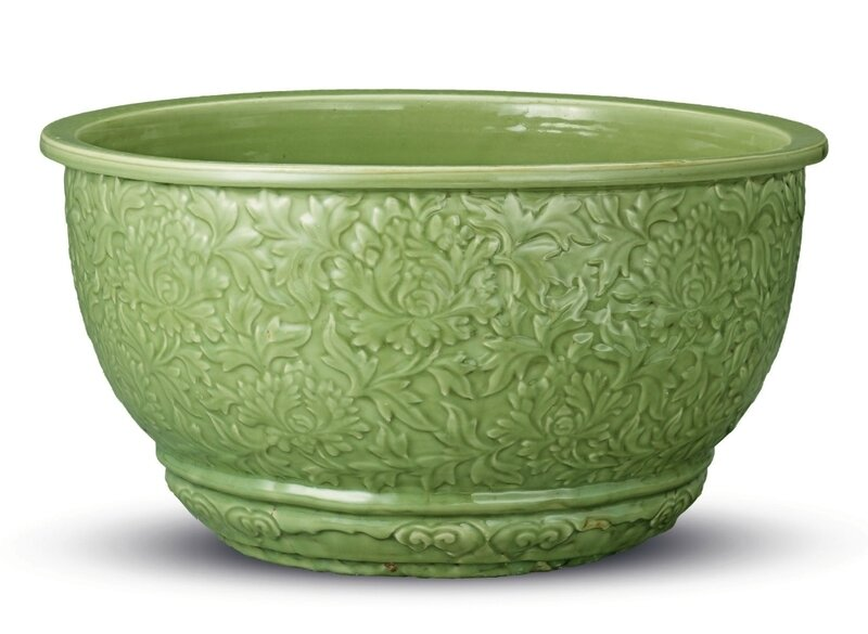 A rare massive carved Longquan celadon jardiniere, Ming dynasty, early 15th century