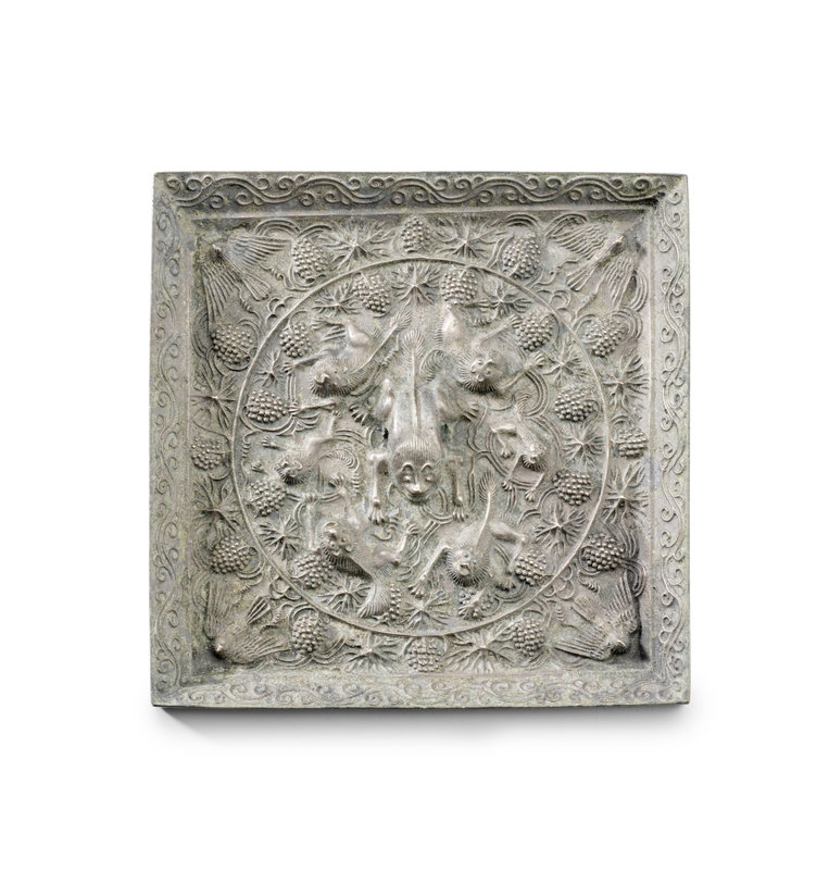 A rare large silvered-bronze square 'lion and grapevine' mirror, Tang Dynasty, 7th-8th Century