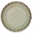 A rare small Junyao green-glazed 'chrysanthemum' dish, 13th-14th century